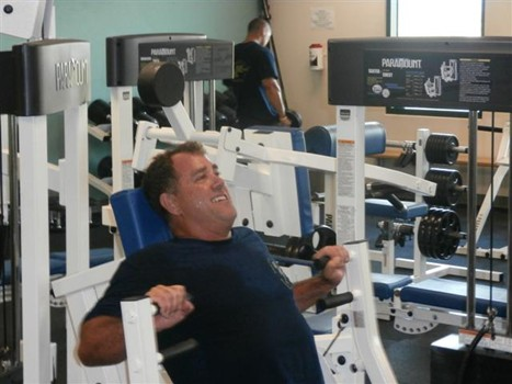 photo of an officer working out in the KPD weight room