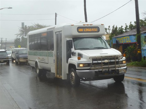 photo of The Kauai Bus driving in the rain