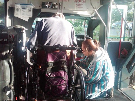 bus driver assisting wheelchair passenger